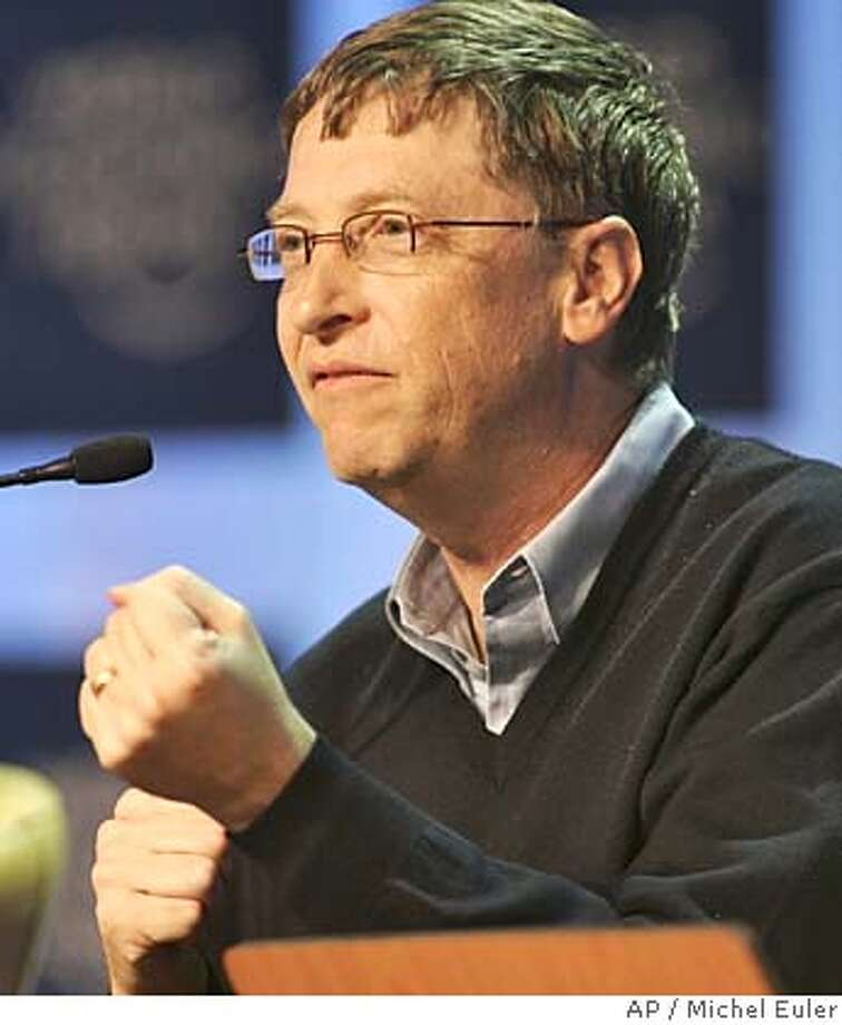 Microsoft Chairman Bill Gates gestures while speaking during the plenary 'Funding the War on Poverty' at the World Economic Forum in Davos, Switzerland, Friday Jan. 28, 2005. (AP Photo/Michel Euler) Photo: MICHEL EULER