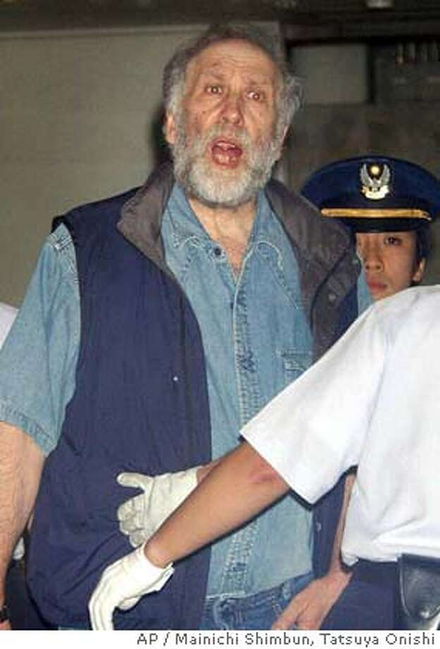 ** FILE ** Former U.S. chess world champion Bobby Fischer is escorted out of the Narita Immigration branch office as he is transferred to the East Japan Immigration Center in Narita, near Tokyo, in this Aug. 10, 2004 file photo. Japan's Justice Ministry rejected former chess champion Bobby Fischer's demand for protection as political refugee on Tuesday, Aug. 24, 2004 and issued an order to deport him. (AP Photo/Mainichi Shimbun, Tatsuya Onishi) ** JAPAN OUT ONLINE OUT MANDATORY CREDIT ** AUG. 10, 2004 FILE PHOTO; JAPAN OUT ONLINE OUT MANDATORY CREDIT Ran on: 08-25-2004  Bobby Fischer Photo: TATSUYA ONISHI