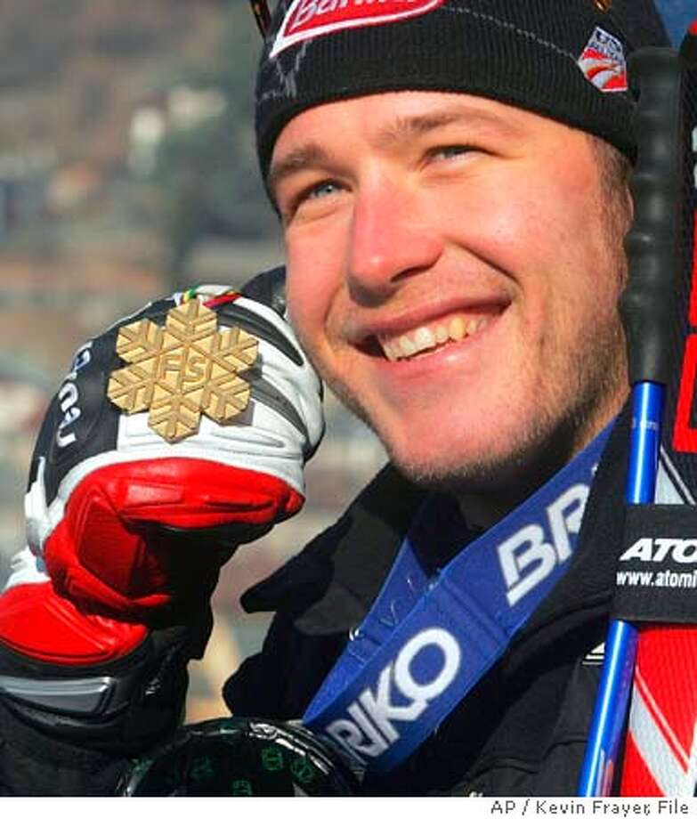 "** FILE ** Bode Miller of the United States, poses with his gold medal after winning the Men's Downhill at the World Alpine Ski Championships in Bormio, Italy, Saturday Feb. 5, 2005. Hailed by Italian newspapers as the ""Cowboy of the Snows,"" Miller already has two golds and the chance for more medals in the next few days. In the only event he failed to win, he lost a ski and then thrilled fans by sliding down the course on one ski. (AP Photo/Kevin Frayer,file) FEB. 5, 2005 FILE PHOTO Photo: KEVIN FRAYER"