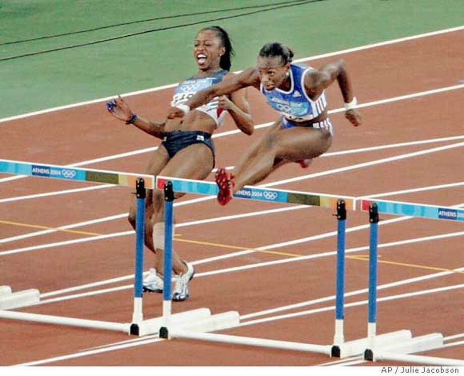 Gail Devers, of the United States, pulls up short of the first hurdle in a qualifying heat of the 100-meter hurdles at the Olympic Stadium during the 2004 Olympic Games in Athens, Sunday, Aug. 22, 2004. Devers hurt her leg in practice a week ago and wore a heavy bandage during three rounds of the 100 meters on Friday and Saturday before being eliminated in the semifinals. (AP Photo/Julie Jacobson) Ran on: 08-23-2004 Photo: JULIE JACOBSON