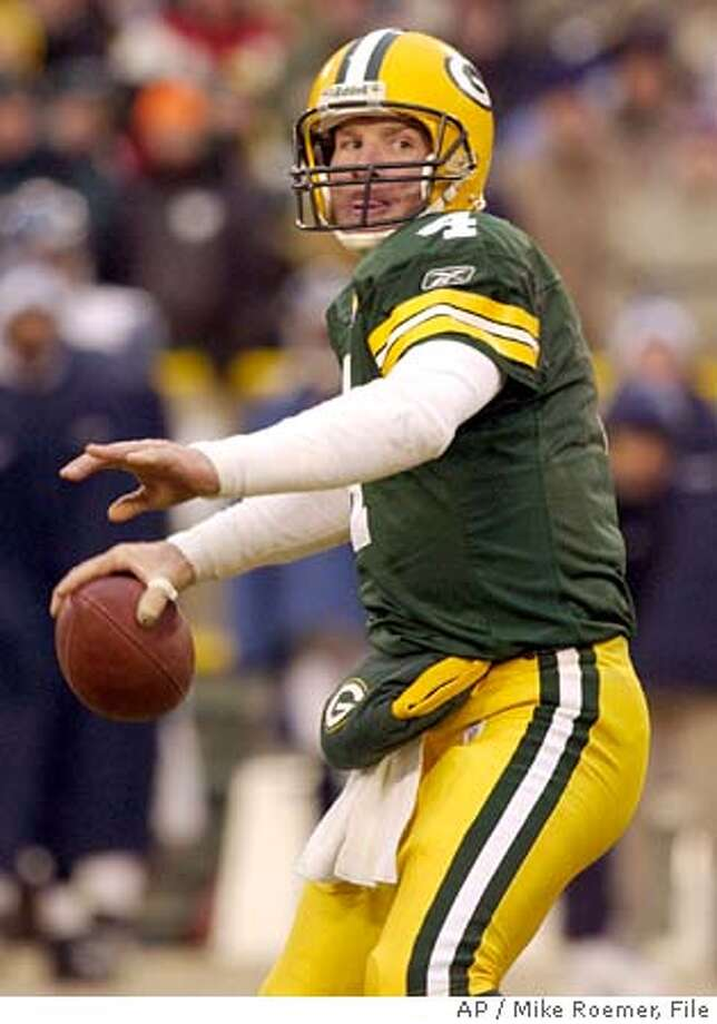 ** ADVANCE FOR WEEKEND EDITIONS, NOV. 6-7 ** FILE ** Green Bay Packers quarterback Brett Favre (4) throws a pass during the NFC Wild Card game against the Seattle Seahawks in this Jan. 4, 2004 photo, in Green Bay, Wis. Favre has no idea why he plays his best football when things are at their worst. He figures he just focuses more, using the game as his three-hour escape from the adversity, which has been particularly intense this season. He's played through injury and a heavy heart over another death in the family and his wife's cancer diagnosis. Along the way, he's helped the Packers win three straight to climb back to 4-4. (AP Photo/Mike Roemer)  ALSO RAN 01/09/05  Ran on: 11-14-2004  Brett Favre is one of nine QBs on pace to throw for at least 4,000 yards. Ran on: 11-14-2004  Brett Favre is one of nine QBs on pace to throw for at least 4,000 yards. Ran on: 01-09-2005  Green Bay's Brett Favre has played through injury and a heavy heart over deaths to loved ones and his wife's cancer diagnosis. Ran on: 01-09-2005  Green Bay's Brett Favre has played through injury and a heavy heart over deaths to loved ones and his wife's cancer diagnosis. Ran on: 01-09-2005  Green Bay's Brett Favre has played through injury and a heavy heart over deaths to loved ones and his wife's cancer diagnosis. ADVANCE FOR WEEKEND EDITIONS, NOV. 6-7 JAN 4, 2004 FILE PHOTO Photo: MIKE ROEMER