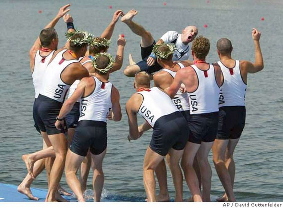 Members of the American Men's Eight boat throw their coxswain Pete Cipollone in the water after they won the gold medal at the 2004 Olympic Games in Schinias near Athens, Greece, Sunday, Aug. 22, 2004. (AP Photo/David Guttenfelder) Photo: DAVID GUTTENFELDER
