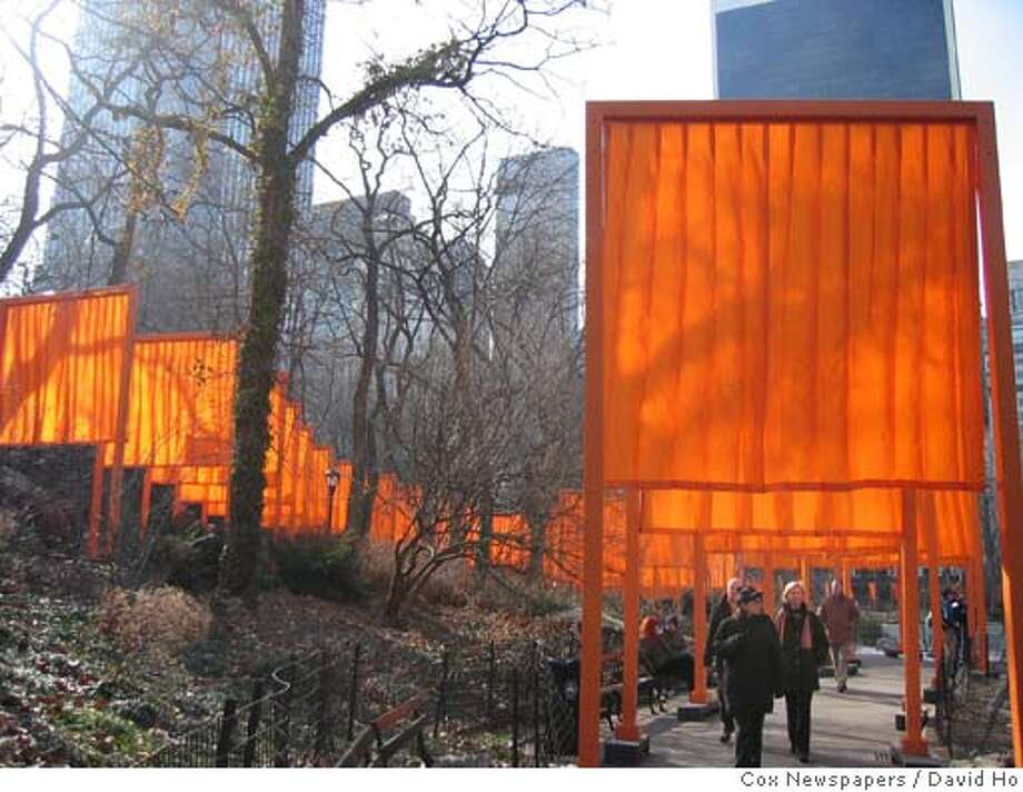 Photo by David Ho/Cox Newspapers  slug: COX-NY-CHRISTO13  NEW YORK... 'The Gates, Central Park, New York, 1979-2005' by artists Christo and Jeanne Claude, is displayed along 23 miles of paved paths throughout Central Park, it's the largest public art display in New York City History. 'The Gates', which was unveiled Saturday, Feb. 12, 2005, will be in Central Park until February 27. (Photo by David Ho/Cox Newspapers) Photo: DAVID HO