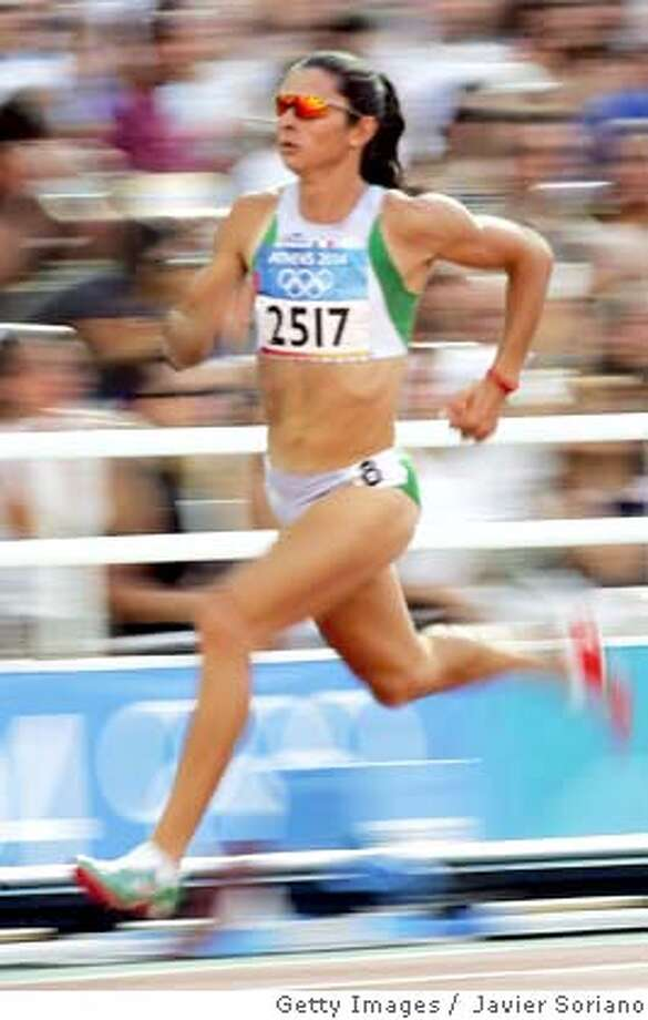 Mexico's Ana Guevara competes in heat one, round one of the women's 400m race, 21 August 2004, during the Olympic Games athletics competitions at the Olympic Stadium in Athens. Guevara won the heat.  AFP PHOTO/JAVIER SORIANO (Photo credit should read JAVIER SORIANO/AFP/Getty Images) DV Photo: JAVIER SORIANO