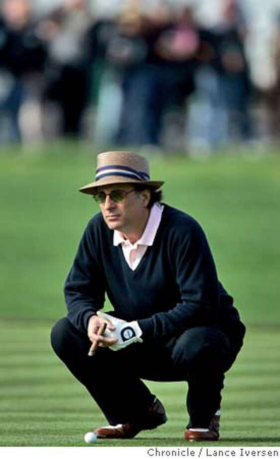 AT&T021.jpg_  Third round action of the AT&T Pebble Beach National Pro- Am Golf Championship.Actor Andy Garcia injoys a cigar while waiting his turn to chip onto the 2nd hole at Pebble Beach Saturday. By Lance Iversen/San Francisco Chronicle Photo: Lance Iversen