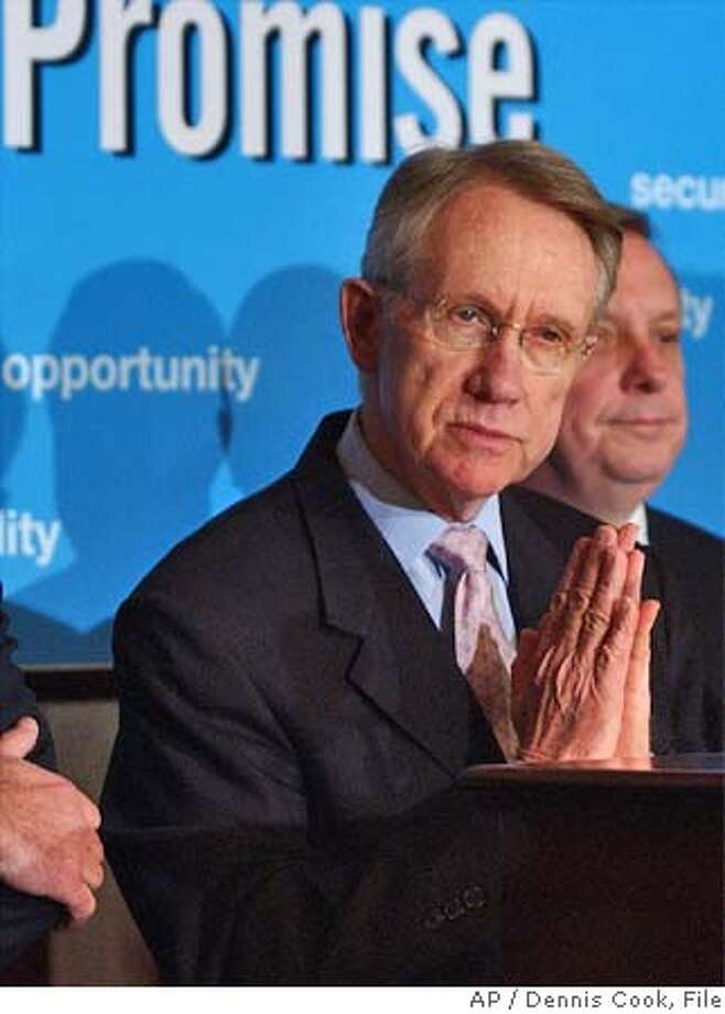 Democratic Minority Leader Harry Reid, D-Nev., discusses the Democratic leadership's agenda for the 109th Congress during a news conference on Capitol Hill Monday, Jan. 24. 2005. At right is Sen. Richard Durbin, D-Ill. (AP Photo/Dennis Cook) Photo: DENNIS COOK