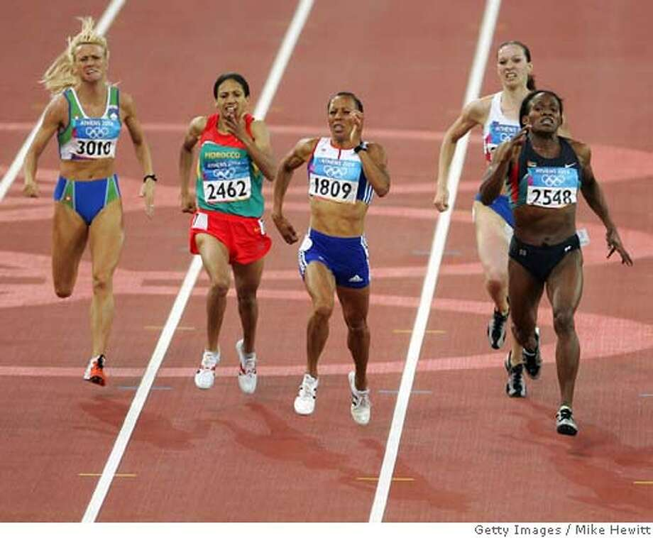 ATHENS - AUGUST 23: Kelly Holmes of Great Britain (1809) runs past Maria de Lurdes Mutola of Mozambique in the women's 800 metre final on August 23, 2004 during the Athens 2004 Summer Olympic Games at the Olympic Stadium in the Sports Complex in Athens, Greece. Kelly Holmes won gold, Hasna Benhassi of Morocco came second and Jolanda Ceplak of Slovenia. (Photo by Mike Hewitt/Getty Images) *** Local Caption *** Kelly Holmes;Maria de Lurdes Mutola (CHINA OUT until Sep 12th 2004) (NEWSWEEK, US NEWS & WORLD REPORT OUT until Sep 12th 2004) Photo: Mike Hewitt