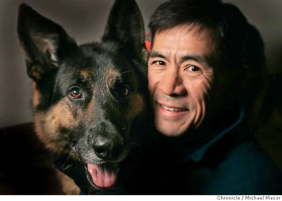 "Dr. Ben Ho is involved with search and rescue and may be going to Indonesia as a physician any day now. He trains and keeps rescue dogs. With his dog. Argus who is a ""Live Find"" rescue dog, people who may be trapped under rubble or debris. 1/7/05 Moraga, Ca Michael Macor / San Francisco Chronicle Photo: Michael Macor"