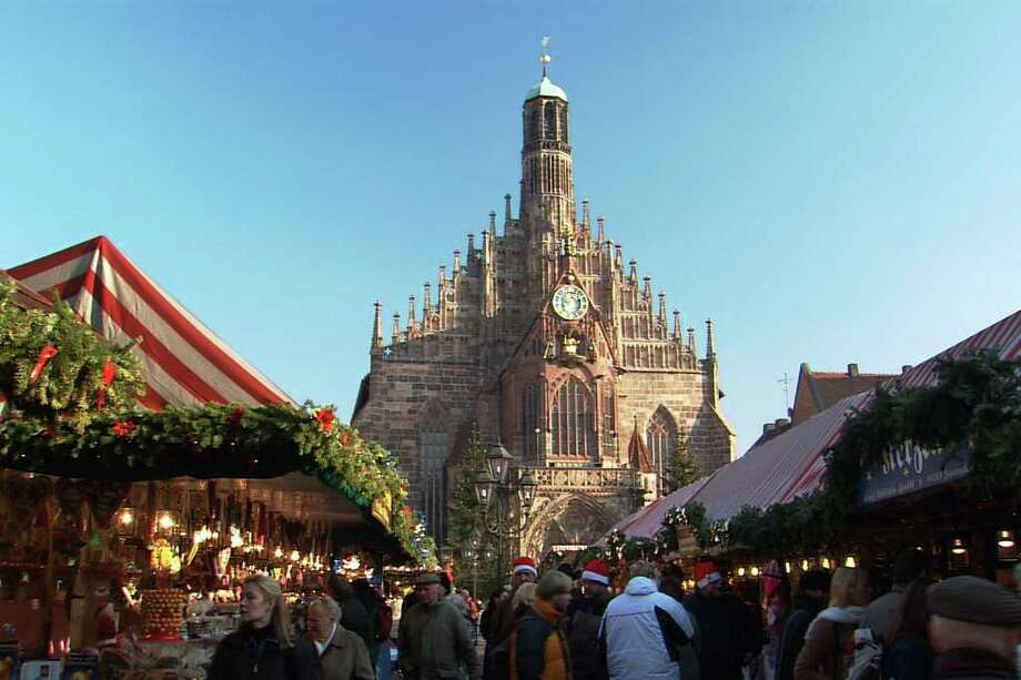 Nürnberg's cathedral towers over the city's Christmas market, the largest of its kind in Germany. Photo: ETBD, Ricksteves.com