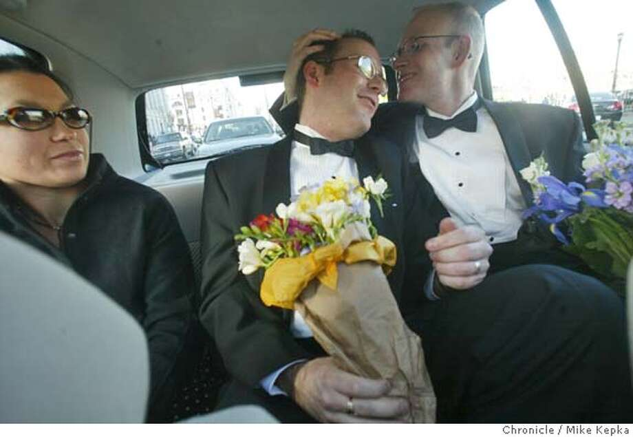 Kyle&Chris0255_mk.jpg  February 2004- After their San Francisco City Hall wedding, Kyle Minor and Christopher Myers embrace in the back seat of a friends as they are driven away. --- After meeting in Pittsburg, PA, 9 years ago, San Francisco couple, Kyle Minor, 35, and Christopher Myers, 32, decided to plan a big party style wedding where all of their family members and friends could attend, but when they saw hundreds of same-sex couple heading for San Francisco City Hall to get married they decided they needed to join the movement and skip their former plans.  Mike Kepka / The Chronicle MANDATORY CREDIT FOR PHOTOG AND SF CHRONICLE/ -MAGS OUT Photo: Mike Kepka