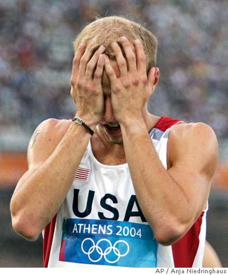 Alan Webb of the U.S. reacts after finishing a heat of the 1500m at the 2004 Olympic Games Friday, Aug. 20, 2004 in Athens, Greece. (AP Photo/Anja Niedringhaus) Photo: ANJA NIEDRINGHAUS