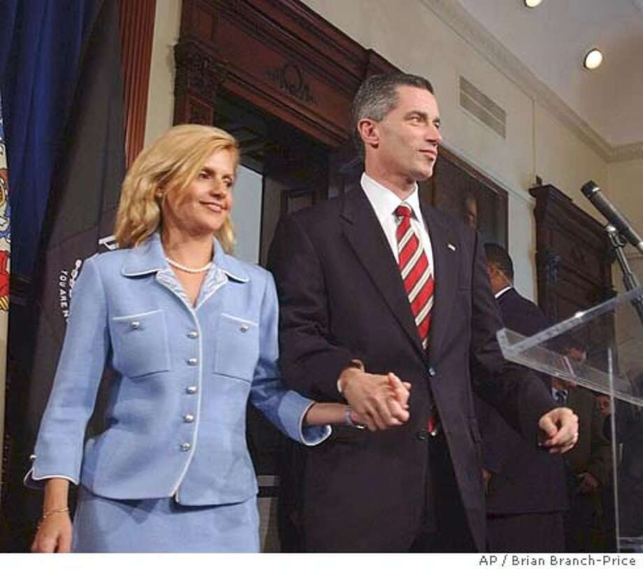 *** CORRECTS SPELLING TO DINA MATOS MCGREEVEY ** New Jersey Gov. James E. McGreevey, right, holds his wife Dina Matos McGreevey's hand, before announcing he will resign, during a news conference at the Statehouse in Trenton, N.J., Thursday, Aug. 12, 2004. In a stunning declaration, McGreevey announced his resignation Thursday and acknowledged that he had an extramarital affair with another man. The Democrat said his resignation would be effective Nov. 15. (AP Photo/Brian Branch-Price) Ran on: 08-13-2004  Gov. James McGreevey Ran on: 08-13-2004  Gov. James McGreevey Ran on: 08-13-2004  Gov. James McGreevey Ran on: 08-13-2004  Gov. James McGreevey CORRECTS SPELLING TO DINA MATOS MCGREEVEY Photo: BRIAN BRANCH PRICE