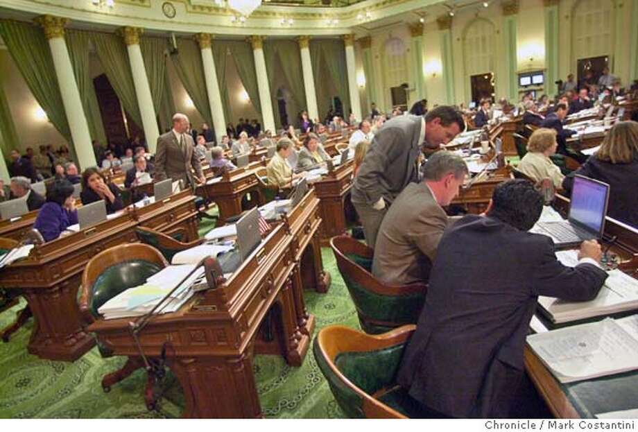 calbudget30_0011.JPG Overall of California State Assembly on the Assembly floor. members working on budget. Scenes at the State Capitol Building during a marathon State Assembly session that's trying to decide on a state budget. Event of 7/29/03 in Sacramento. MARK COSTANTINI / The Chronicle Ran on: 08-22-2004  At the California State Assembly in Sacramento, members work on a marathon budget session. Photo: MARK COSTANTINI