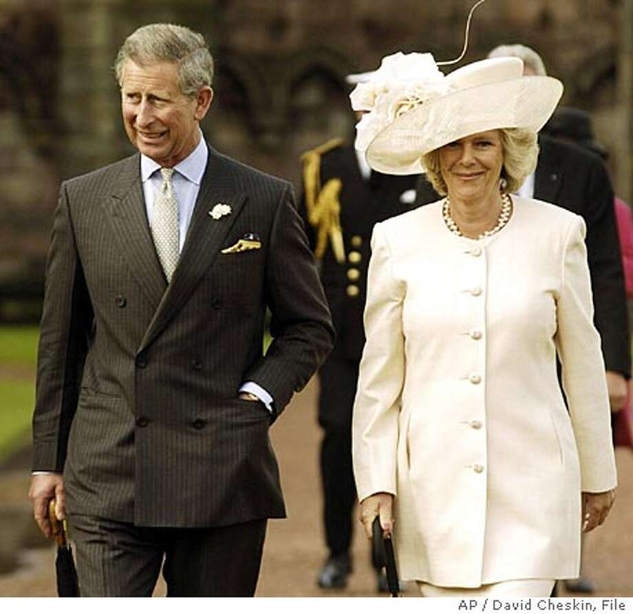 ** FILE ** The Prince of Wales arrives with Camilla Parker-Bowles for a garden party at the Palace of Holyroodhouse in Edinburgh, Scotland in this June 1 2004 file photo. Prince Charles surprised Britain by announcing Thursday, Feb. 10, 2005 that he will marry Camilla Parker Bowles, his longtime lover whom Princess Diana blamed for the breakdown of her marriage to the heir to the throne. (AP Photo/PA, David Cheskin) ** UNITED KINGDOM OUT ** Photo: DAVID CHESKIN