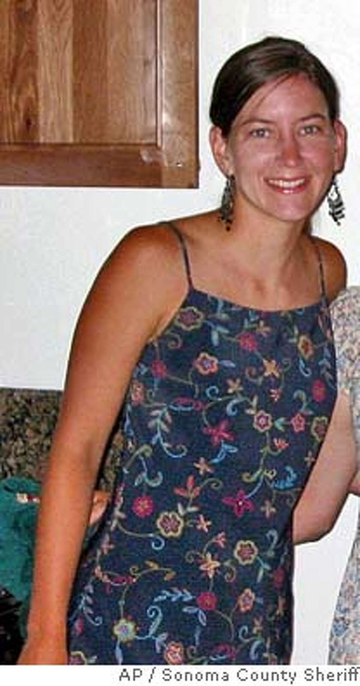 ** FILE ** Lindsay Cutshall is shown in this undated photo. Two camp counselors who were reported missing earlier this week were murdered in their sleep on a Sonoma County beach less than a month before their wedding, authorities said. The bodies of Lindsay Cutshall, 23, and Jason Allen, 26,were discovered in sleeping bags about three miles north of Jenner on Wednesday afternoon, Aug. 18, 2004, when sheriff's deputies were rescuing a stranded hiker, the Sonoma County Sheriff's Department said. (AP Photo/Sonoma County Sheriff) Ran on: 08-21-2004 Two bodies were found at Fish Head Beach in Sonoma County.