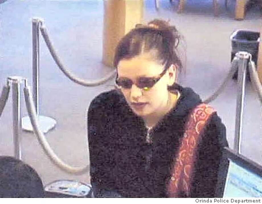Photo of bank robbery suspect in the robbing of a Wells Fargo Bank at 80 Moraga Way in Orinda. The incident occured on Saturday 02-05-2005 at 10:09AM. The suspect used a threatening note to conduct the robbery and was seen leaving the scene in a silver Honda CRV with a spare wheel attached to the rear hatch. Photo: Courtesy Of Orinda Police Depart