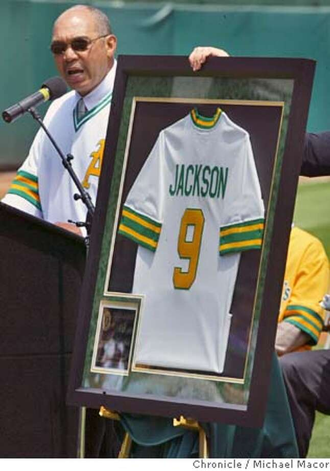 athletics053_mac.jpg Reggie Jackson became the third Oakland Athletic to have his number retired. Reggie speaks to the crowd as a commemorative jersey is presented to him. The Oakland Athletics vs. Kansas City Royals. event on 5/22/04 in Oakland Michael Macor / San Francisco Chronicle Mandatory Credit For Photographer and SF Chronicle/ - Magazines Out Photo: Michael Macor