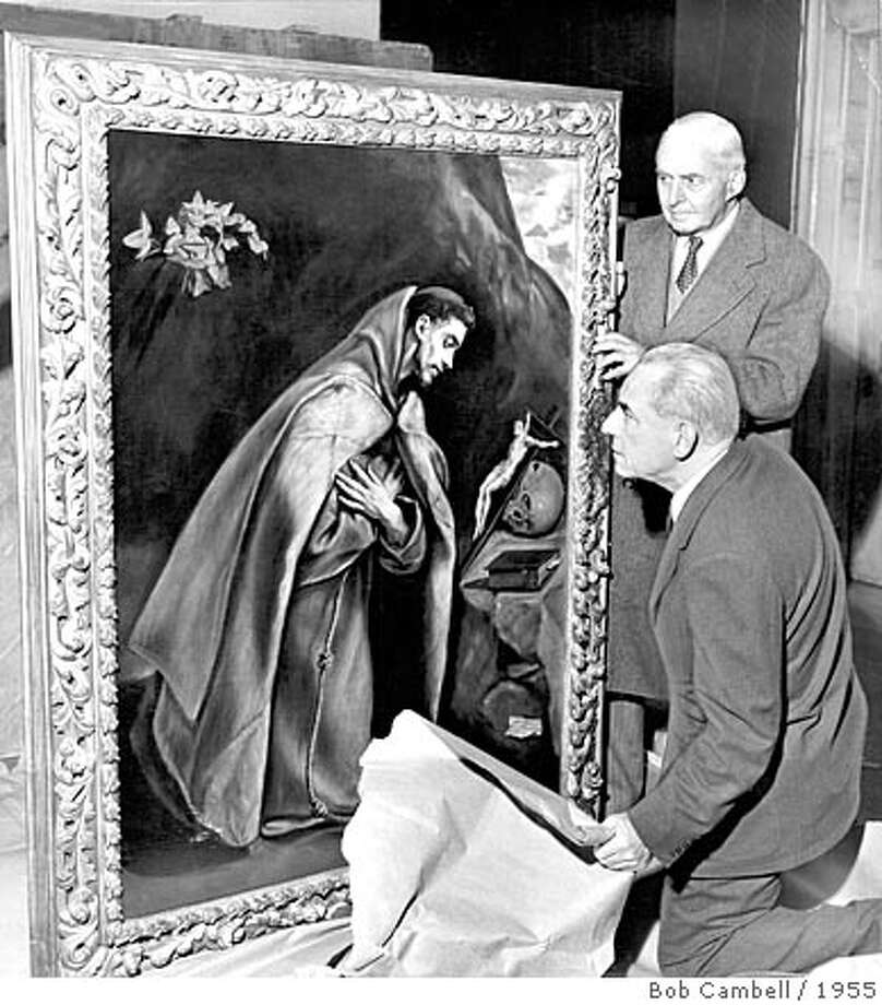 Guy Emmerson (standing) and Dr. Walter Heil (kneeling) examine an El Greco; part of the Kress Colection Photo: Bob Cambell / 1955