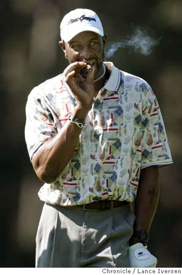 AT&T_196.jpg_  Oakland Raiders wide receiver and future Hall of Famer, jerry Rice relaxes with a cigar on the 4th green at poppy Hills during first round action of the AT&T Pro-Am at Pebble Beach. By Lance Iversen/San Francisco Chronicle MANDATORY CREDIT PHOTOG AND SAN FRANCISCO CHRONICLE. Photo: Lance Iversen