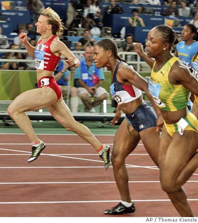 Yuliya Nestertenko, of Belarus, left, wins the 100-meter gold in 10.93 seconds as Lauryn Williams, of the United States, second left finished second in 10.96, and Veronica Campbell, of Jamaica, right, finished third in 10.97 at the Olympic Stadium during the 2004 Olympic Games in Athens, Saturday, Aug. 21 2004. (AP Photo/Thomas Kienzle) Photo: THOMAS KIENZLE