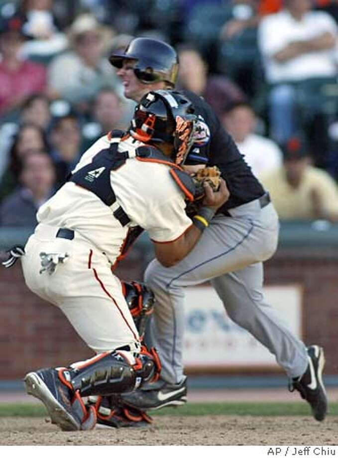 New York Mets' David Wright is tagged out at home by San Francisco Giants catcher Yorvit Torrealba on a first base to home double play in the 12th inning in San Francisco on Saturday, Aug. 21, 2004. The Mets won, 11-9, in 12 innings. (AP Photo/Jeff Chiu) Photo: JEFF CHIU
