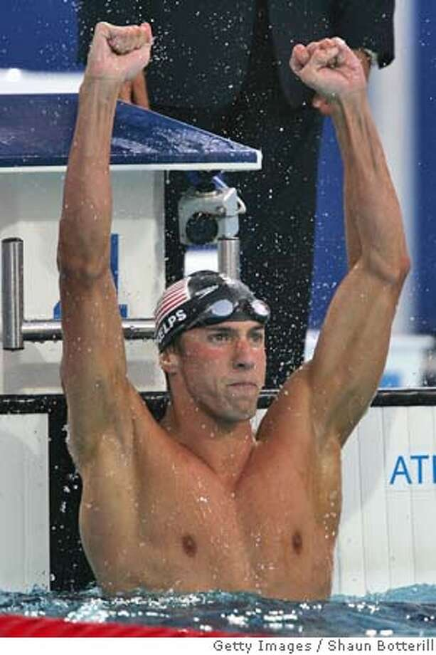 ATHENS - AUGUST 20: Michael Phelps of the United States celebrates winning the gold medal in the men's swimming 100 metre butterfly final on August 20, 2004 during the Athens 2004 Summer Olympic Games at the Main Pool of the Olympic Sports Complex Aquatic Centre in Athens, Greece. (Photo by Shaun Botterill/Getty Images) *** Local Caption *** Michael Phelps Photo: Shaun Botterill