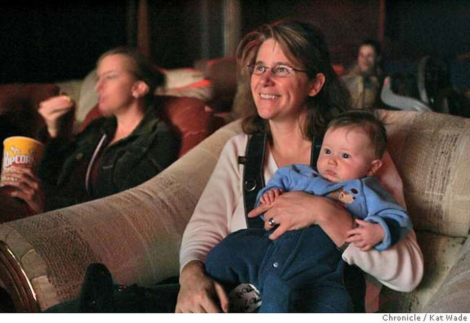 JOHNSON11_092_KW.jpg  On 2/10/05 in Alameda Page Tomblin and her son Theo Wilson, 3mos., (RIGHT) watch the movie Incredibles with their moms group from Alameda in Mark Haskett's movie house Central Cinema on Central Avenue with other moms Denise Wharton-Morris (LEFT) and Samantha Hack (FAR RIGHT)Since Haskett opened the cinema in December the city has attempted to shut down his cosy theatre filled with sofas and easy chairs that holds about three dozen theatre goers at a time. Kat Wade/ The Chronicle MANDATORY CREDIT FOR PHOTOG AND SF CHRONICLE/ -MAGS OUT Photo: Kat Wade