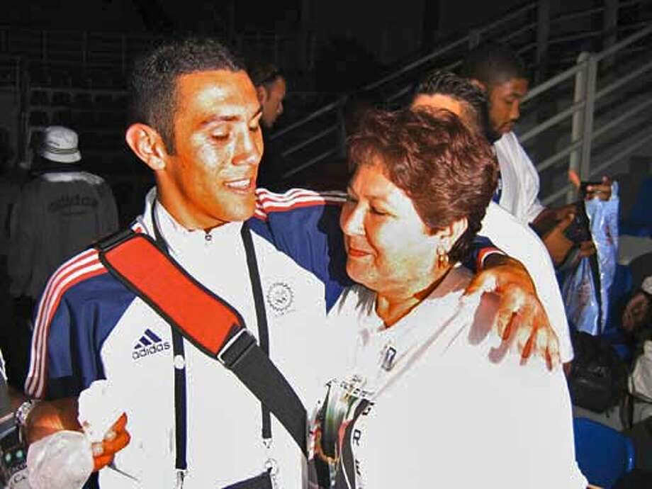 Vicente Escobedo hugs his mother, Marguerita Rodriguez, after his lightweight victory over Jose David Mosquera. Photo by Vivienne Walt, special to the Chronicle