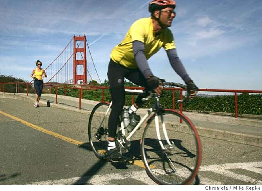 "Duncan Briggs of San Francisco, who ride his bike across the bridge nearly every day, said, ""People should be rewarded for not using gasoline."" He can be reached at 415 648-0826. Pedestians and bike riders talk about the possability of a toll to cross the Golden Gate bridge even if you are not in a car.  Mike Kepka / The Chronicle Photo: Mike Kepka"