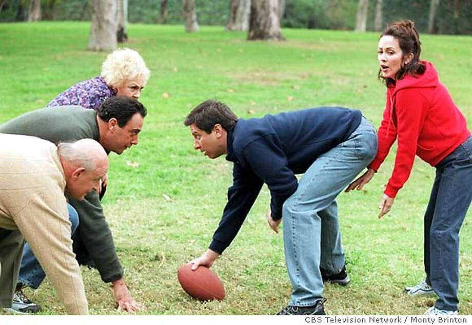 THIS IS A HANDOUT IMAGE. PLEASE VERIFY RIGHTS. GOODMAN11c-C-06FEB02-DD-HO  Ray Romano, Patricia Heaton, Brad Garrett, Doris Roberts and Peter Boyle, the cast of the hit CBS comedy EVERYBODY LOVES RAYMOND (seen Mondays, 9:00-9:30 PM, ET/PT), got together to release a little family tension on the field in preparation for the CBS broadcast of the Super Bowl. The cast is pictured shooting a promo for the Jan. 28 event to be aired on the CBS Television Network.  photo: Monty Brinton / CBS Photo: MONTY BRINTON