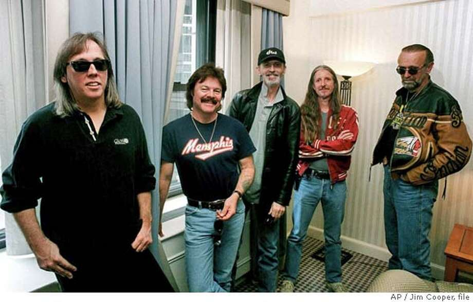 "** FILE ** The classic rock group pose in a New York hotel, Sept. 18, 2000. The band, who was at the height of their popularity in the 1970s with such No. 1 hits as ""Black Water,"" have a new CD titled ""Sibling Rivalry,"" released in October on Pyramid Records. From left are John McFee, Tom Johnston, Keith Knudsen, Patrick Simmons and Michael Hossack. Knudsen, a drummer for since 1974, died of pneumonia Tuesday. He was 56. Knudsen, who lived in Sonoma County's wine country, had been hospitalized for more than a month. He died at Kentfield Rehabilitation Hospital at about 12:30 p.m., according to the band's longtime manager Bruce Cohn. (AP Photo/Jim Cooper) Photo: JIM COOPER"