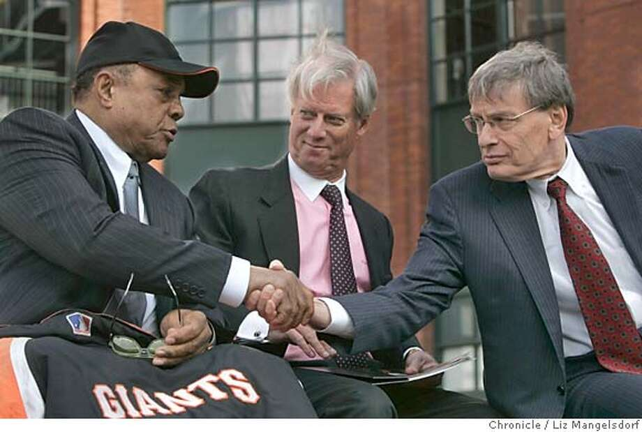 giants10_165_lm.JPG Event on 2/9/05 in San Francisco.  Baseball Commissioner Bud Selig, right, shakes hands with former Giant Willie Mays, with Peter Magowan looking on, after the All-Star announcement.  The announcement of the 2007 All-Star game being played at SBC park. The announcement was made at Willie Mays Plaza, on the corner of Third and King Sts. at SBC Park.  Liz Mangelsdorf / The Chronicle MANDATORY CREDIT FOR PHOTOG AND SF CHRONICLE/ -MAGS OUT Photo: Liz Mangelsdorf