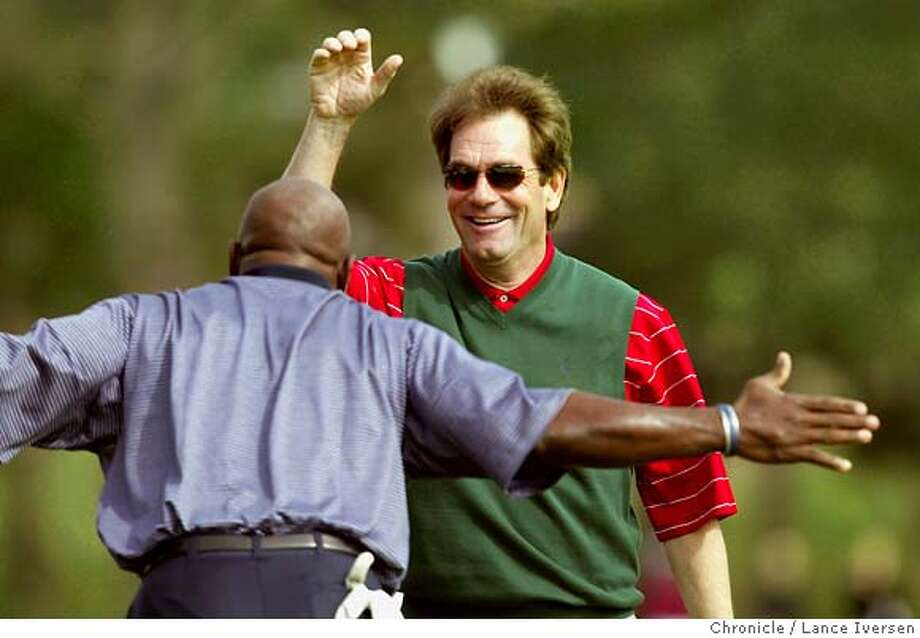 AT&T_185.jpg_  Former NFL start Emmitt Smith bows to Huey Lewis after Lewis flied his chip shot into the cup for a birdie on 3rd hole at Pebble Beach Wed during the annual 3M Celebrity Challenge. Lewis won the hole and earned $4,000 for his charity Camp Okisu. By Lance Iversen/San Francisco Chronicle Photo: Lance Iversen