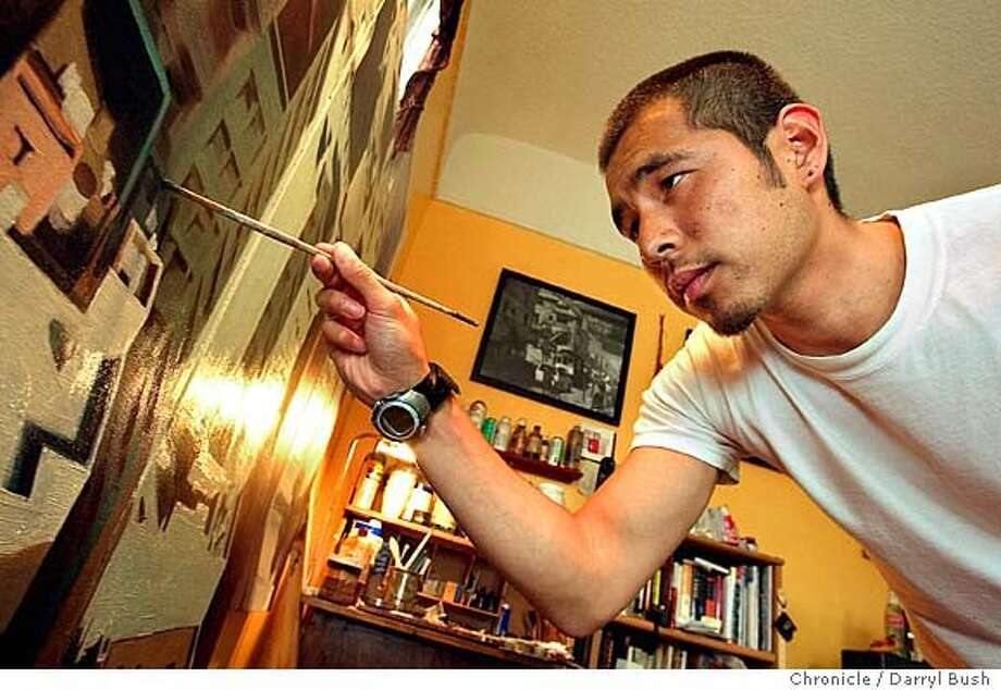 Artist Kim Cogan paints a painting of downtown San Francisco in his apartment. 7/27/04 in San Francisco  Darryl Bush / The Chronicle Photo: Darryl Bush