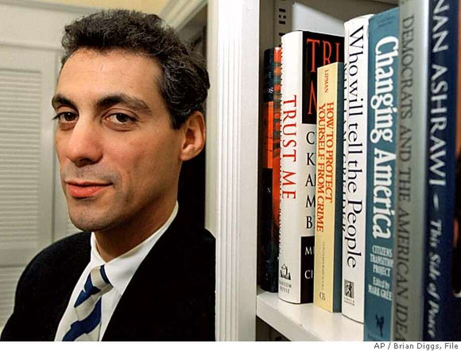 ** FILE ** Senior presidential adviser to President Clinton, Rahm Emanuel, stands in his coveted White House Office Feb. 7, 1997. Rep. Rahm Emanuel, D-Ill., is a new political point man for out-of-power congressional Democrats, who must gain 15 House seats in 2006 to reclaim a majority they lost a decade ago. (AP Photo/Brian Diggs, File) Photo: BRIAN DIGGS