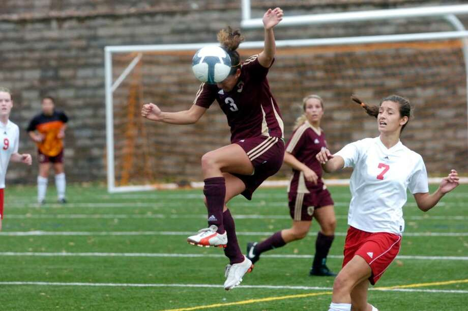 St. Joseph's Sylvia Yanez heads the ball above Greenwich's Meghan Hayden as Greenwich High hosts St. Joseph's of Trumbull in the girls soccer FCIAC quarterfinals Saturday morning, Oct. 31, 2009. Greenwich won the game. Photo: Keelin Daly / Greenwich Time