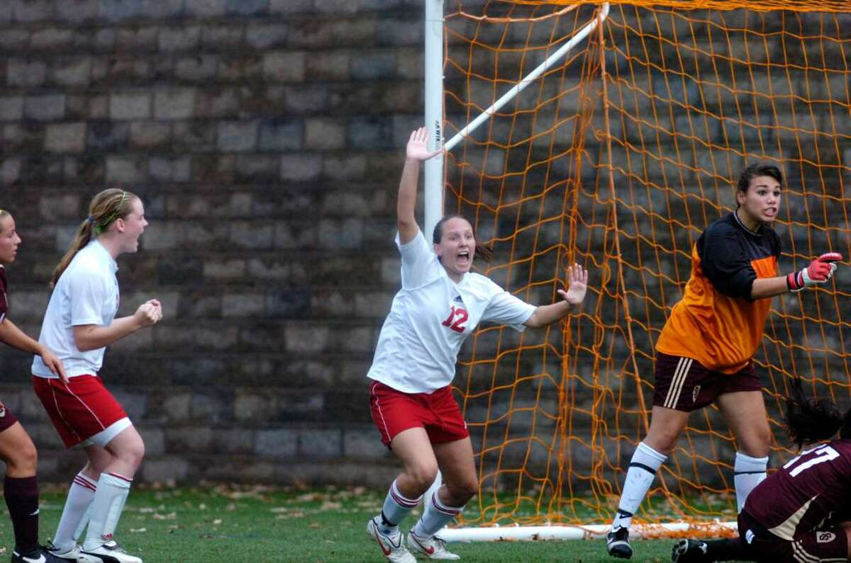 Greenwich's Courtney Callahan, center, and St. Joseph's goalie Nina Scarpetti react to Callahan's goal as Greenwich's Shannon Colligan, left celebrates as Greenwich High hosts St. Joseph's of Trumbull in the girls soccer FCIAC quarterfinals Saturday morning, Oct. 31, 2009. Greenwich won the game.