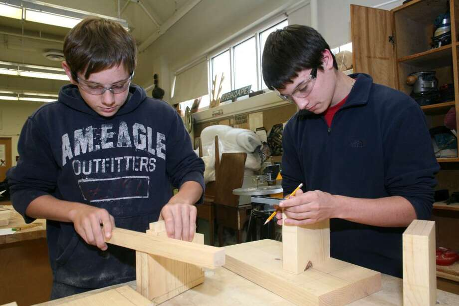 "Greenwich High School tenth graders Peter Kelly and Chris Cantavero work on their projects in the ""Design Build"" class which is currently the most popular elective offered in the Technology Education Department at GHS. Photo: David Ames / Greenwich Time"