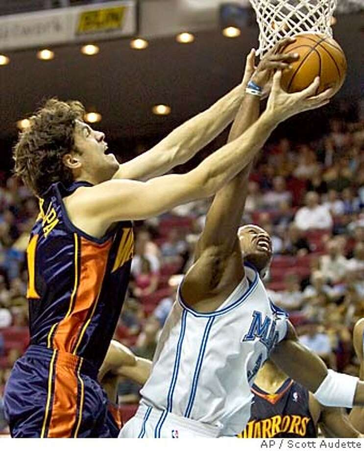 Golden State Warriors's Zarko Cabarkapa, of Serbia-Montenegro, left, fights for a rebound with the Orlando Magic's Steve Francis, right, during the first quarter on Tuesday, Feb. 8, 2005 in Orlando, Fla. (AP Photo/Scott Audette) Photo: SCOTT AUDETTE