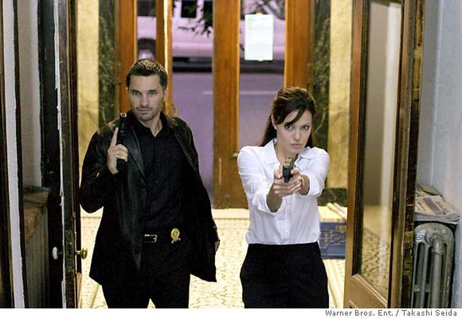 "for preview04; (L-r) OLIVIER MARTINEZ and ANGELINA JOLIE in the psychological thriller ""Taking Lives,"" distributed by Warner Bros. Pictures. The film also stars Ethan Hawke.  PHOTOGRAPHS TO BE USED SOLELY FOR ADVERTISING, PROMOTION, PUBLICITY OR REVIEWS OF THIS SPECIFIC MOTION PICTURE AND TO REMAIN THE PROPERTY OF THE STUDIO. NOT FOR SALE OR REDISTRIBUTION"