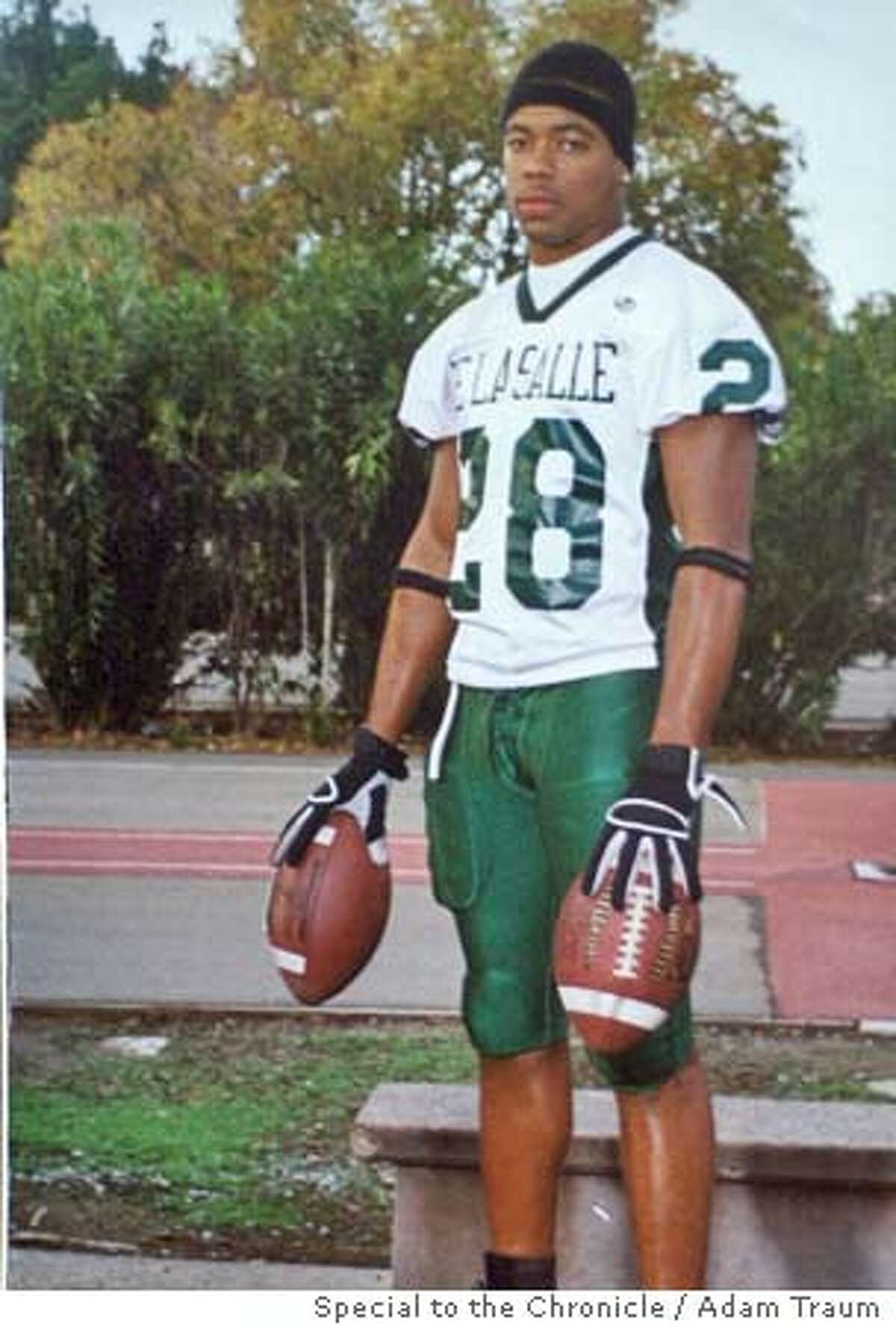 {060404_oakslay05_ckh) Copy photo of De LaSalle football star Terrance Kelly in his high school uniform. Richmond Police have already arrested the 18 year old Larry Pratcher of Richmond in the slaying of De LaSalle football star Terrance Kelly {08/16/04} in {Richmond}. {Adam Traum} / {SF CHRONICLE} MANDATORY CREDIT FOR PHOTOG AND SF CHRONICLE/ -MAGS OUT