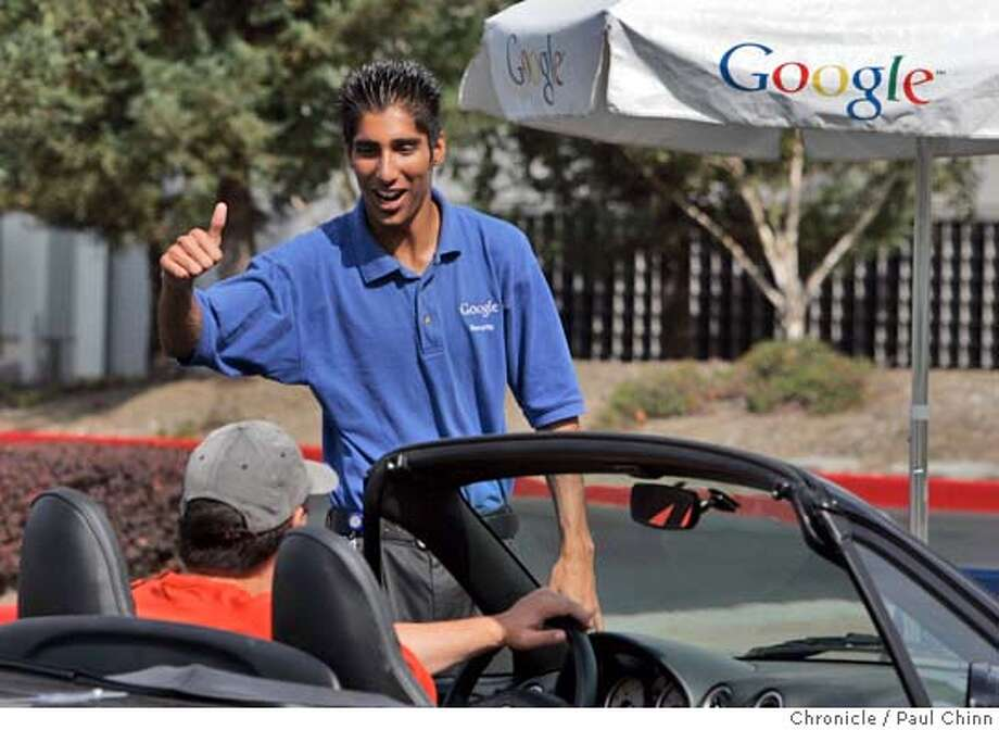 A security guard (who declined to give his name) gave thumbs-up to employees as they entered the Google campus shortly after stocks began trading. The anticipated IPO of Google stock traded for the first time on NASDAQ. Google headquarters in Mountain View on 8/19/04. PAUL CHINN/The Chronicle Photo: PAUL CHINN