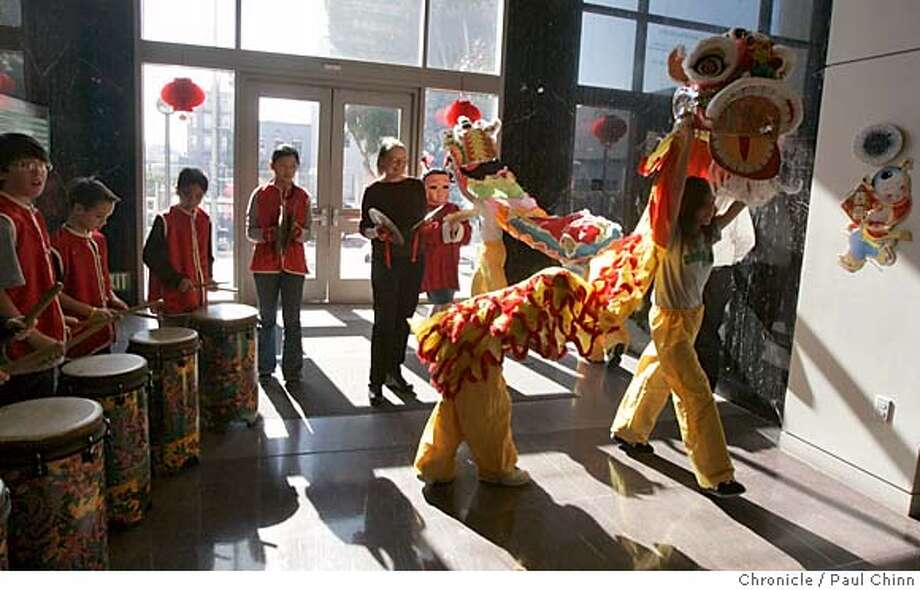 Lion dancers preparing for Chinese New Year festivities perform in the school's main lobby. Sixth-graders born in the year of the rooster 12-years ago rehearse a traditional lion dance at the Chinese American International School on 2/3/05 in San Francisco, CA.  PAUL CHINN/The Chronicle MANDATORY CREDIT FOR PHOTOG AND S.F. CHRONICLE/ - MAGS OUT Photo: PAUL CHINN