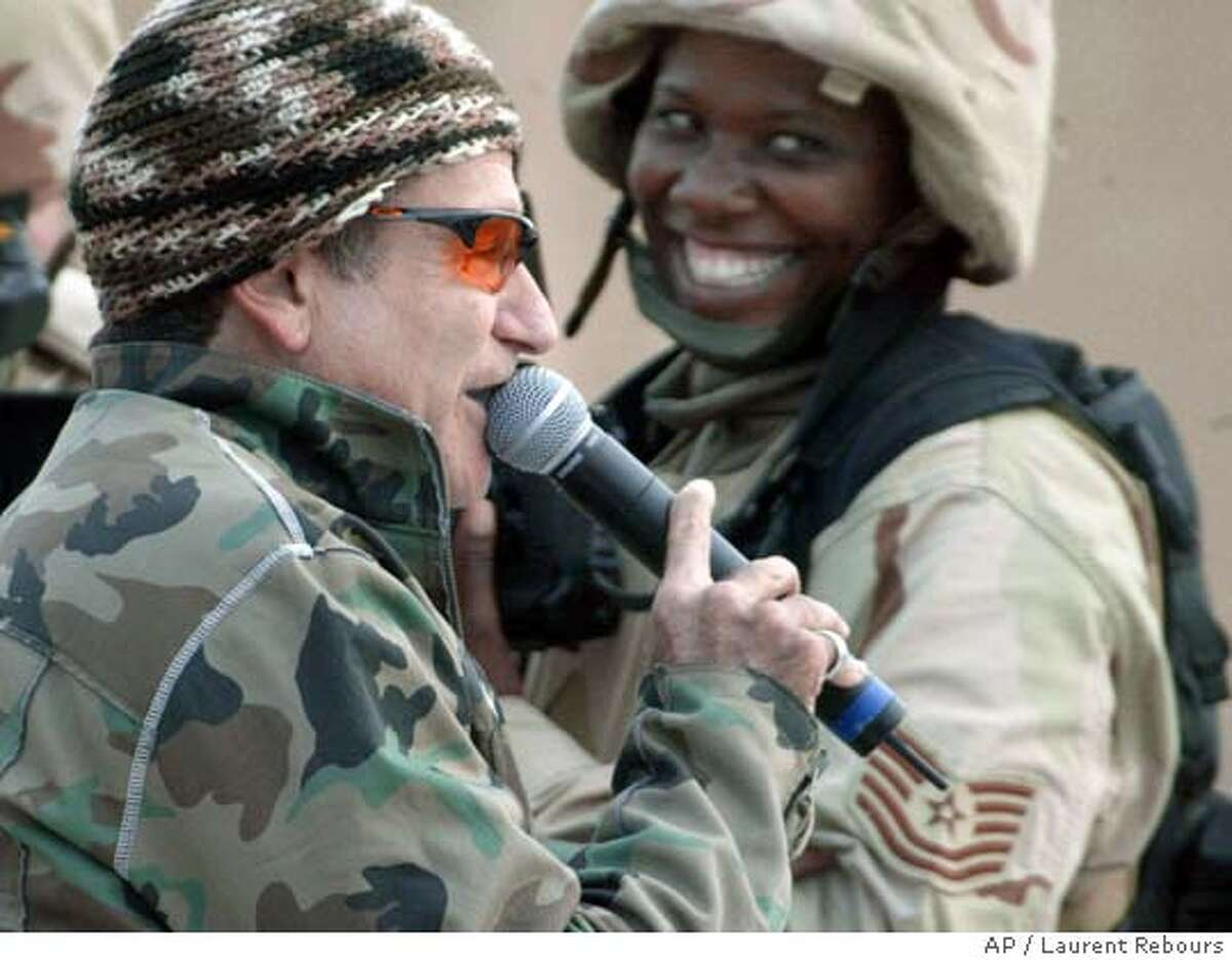 Comedian Robin Williams performs for American troops at the US base in Baghdad's international airport, Iraq Tuesday Dec. 16, 2003 . (AP Photo/Laurent Rebours) Comedian Robin Williams, who lives in San Franciscos Sea Cliff neighborhood, earns GIs grins in a performance for American troops at the base in Baghdads international airport. ProductNameChronicle Comedian Robin Williams, who lives in San Franciscos Sea Cliff neighborhood, earns GIs grins in a performance for American troops at the base in Baghdads international airport.