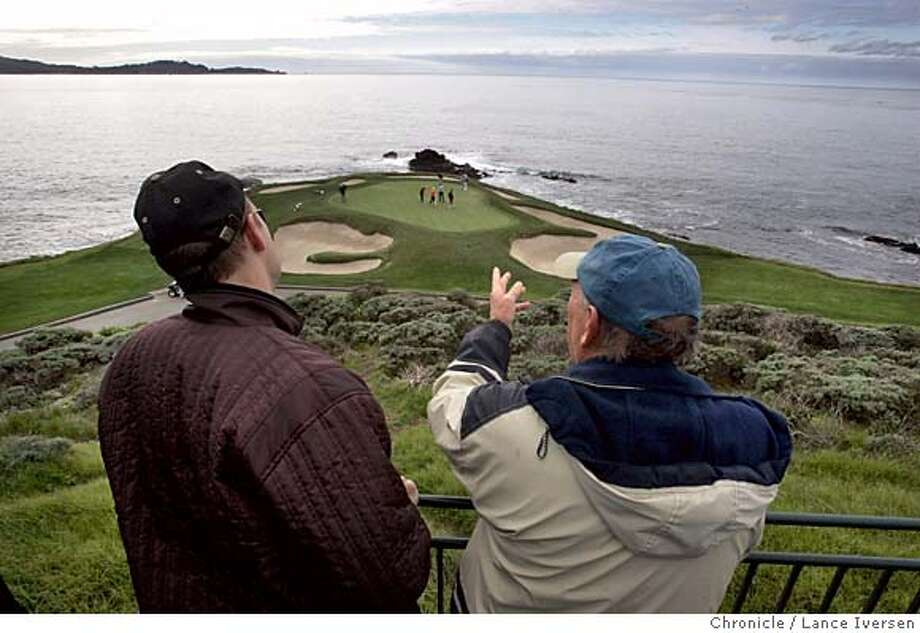 AT&T_217.jpg_  Greg Triber from San Jose talks with his father Bill Triber from Prunedale as the pair over look the 6th green at Pebble Beach that Bill Murray, Matt Kuchar, Larry Mize and Murray's pro pardner Scott Simpson were playing during practice rounds Tuesday for the AT&T Golf Tournament. By Lance Iversen/San Francisco Chronicle MANDATORY CREDIT PHOTOG AND SAN FRANCISCO CHRONICLE. Photo: Lance Iversen