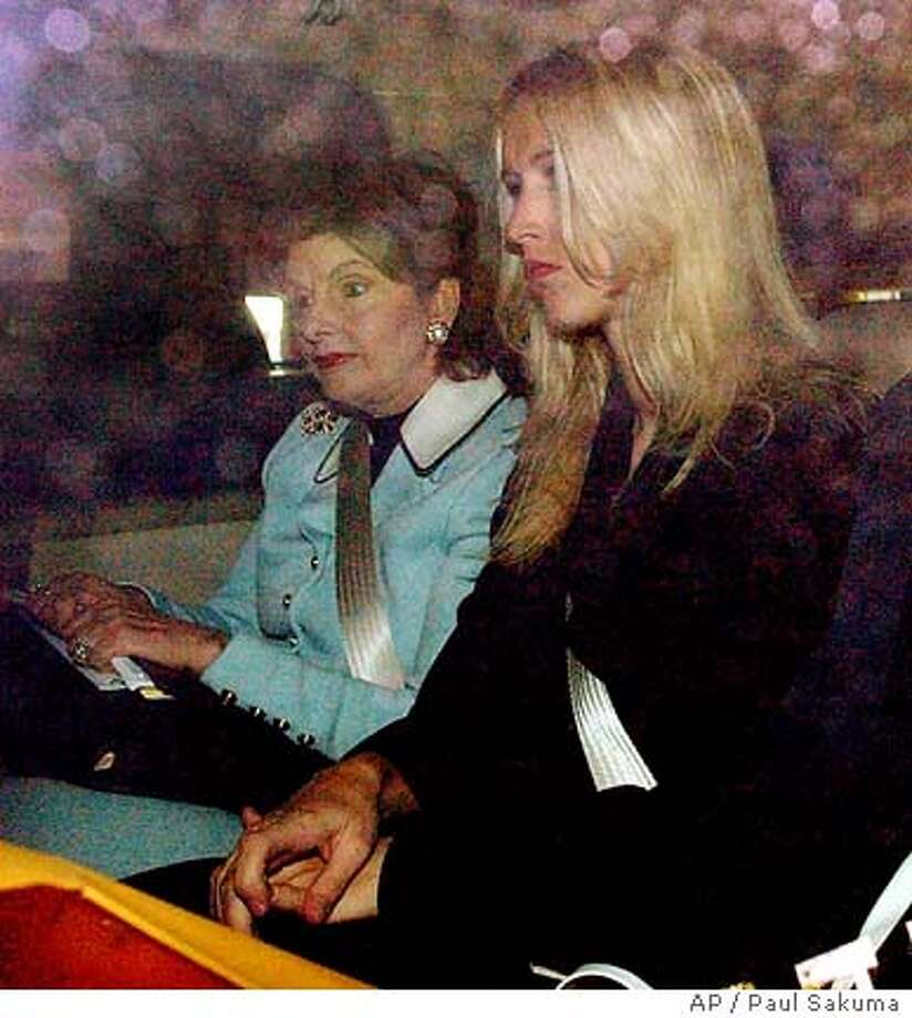 Amber Frey, right, arrives with her attorney Gloria Allred, left, before testifying in the Scott Peterson trial at the Redwood City, Calif., courthouse, Tuesday, Aug. 17, 2004. Peterson is the Modesto, Calif., man who could face the death penalty for the murder of his wife, , and their unborn son. (AP Photo/Paul Sakuma) Photo: PAUL SAKUMA
