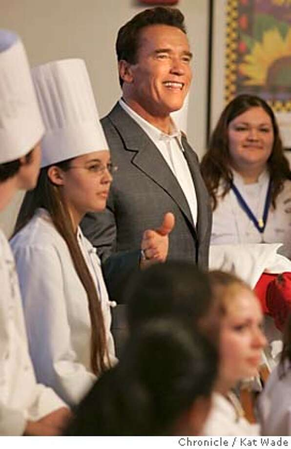 GOVERNOR_224_KW.jpg  On 2/7/05 in Concord Governor Arnold Schwarzenegger tours Mt. Diablo High School's culinary arts program and Serendipity restaurant to highlight his vocational education proposals Monday afternoon. Students (L to R) Mark Long, 18, Rebecca Giron, 17, Schwarzenegger, Lauran (CQ) Hoskins, 18, and in foreground Sonia Perez, 17. Kat Wade / The Chronicle MANDATORY CREDIT FOR PHOTOG AND SF CHRONICLE/ -MAGS OUT Photo: Kat Wade