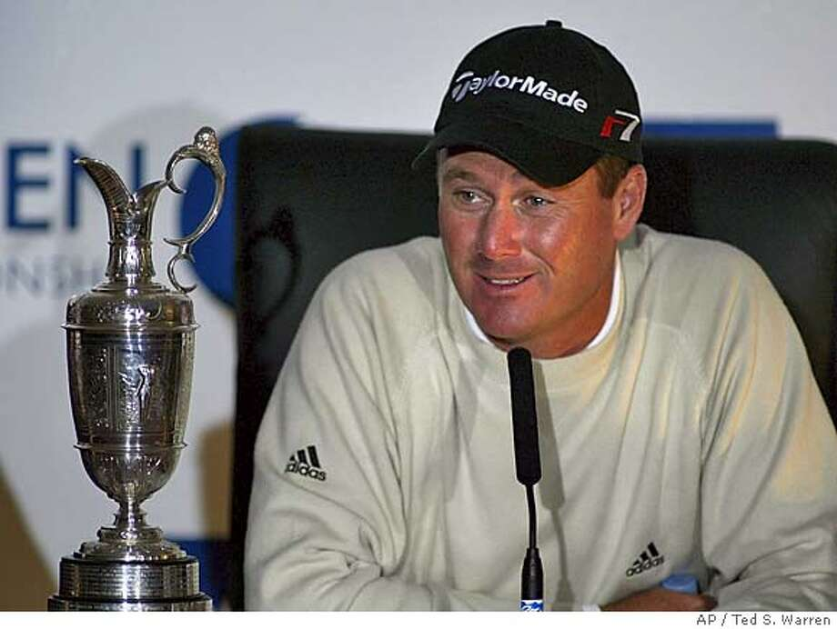 Todd Hamilton of the United States smiles as he sits next to the trophy during a press conference after winning the British Open golf championship at Royal Troon golf course in Troon, Scotland Sunday July 18, 2004. Hamilton won the Open championship after beating South Africa's Ernie Els in a play-off. (AP Photo/Ted S. Warren) ** EDITORIAL USE ONLY ** Ran on: 07-19-2004 Ran on: 07-19-2004 EDITORIAL USE ONLY Photo: TED S. WARREN