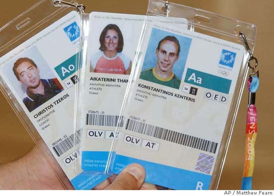 The Athens 2004 Olympic Games accreditation handed back to the International Olympic Committee by Greek athletes Kostas Kenteris, Katerina Thanou and coach Christos Tzekos, are displayed in Athens, Wednesday Aug.18, 2004. Both athletes withdrew from the Olympics nearly a week after they missed a drugs test and, were later hospitalized following a suspicious motorcycle accident.(AP Photo/ Matthew Fearn-pa) ** UNITED KINGDOM OUT: MAGS OUT: : ** UNITED KINGDOM OUT: MAGS OUT: : Photo: MATTHEW FEARN