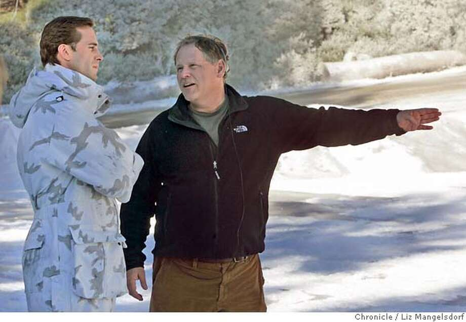 taylor07_068_lm.JPG Event on 2/2/05 in Oakland.  Film director Finn Taylor (right) talks with the star of his film Joseph Fiennes between scenes. He is filming his movie at Joaquin Miller Park in Oakland. There is fake snow on the ground for this scene.  Liz Mangelsdorf / The Chronicle MANDATORY CREDIT FOR PHOTOG AND SF CHRONICLE/ -MAGS OUT Photo: Liz Mangelsdorf